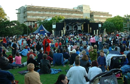 The sun's going down, the people are entertained for New Year in The Square, Palmerston North, Manawatu, New Zealand - 31 December 2003
