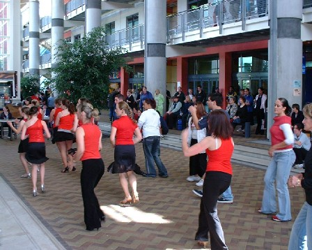 Students, taking a break, have an on-the-spot lesson in 'Street Latin' dance, in the comfort of UCOL's Atrium, Palmerston North, Manawatu, New Zealand - 30 March 2004